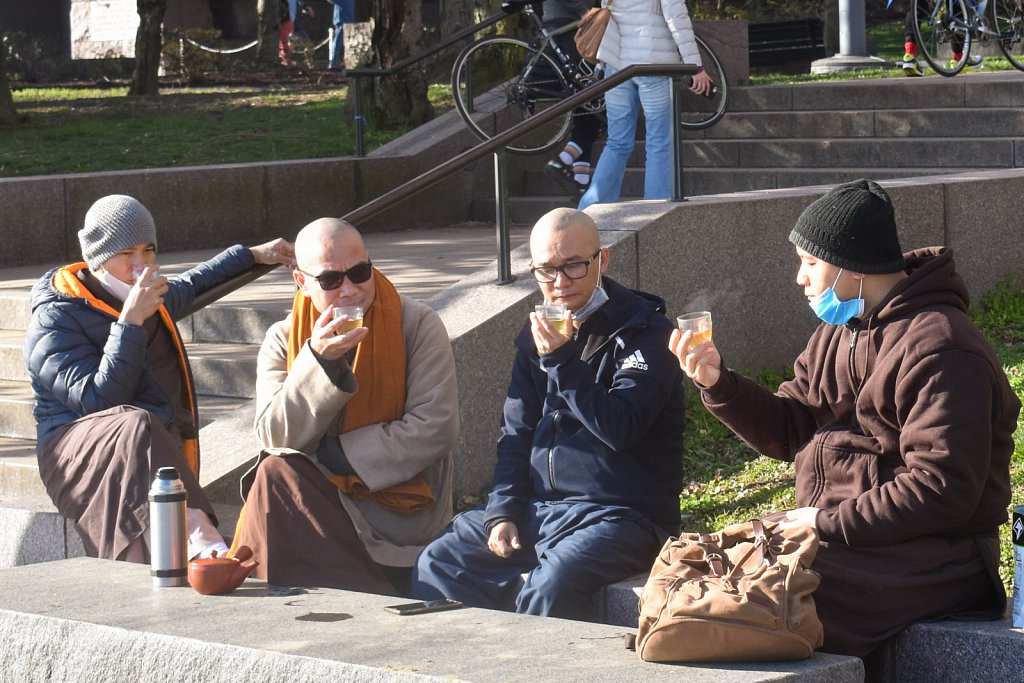 Four gentlemen having tea